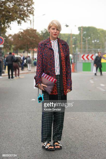 Fashion stylist Elisa Nalin wears a red leopard print jacket and scarf day 2 of Paris Womens Fashion Week Spring/Summer 2018 on September 27 2017 in...
