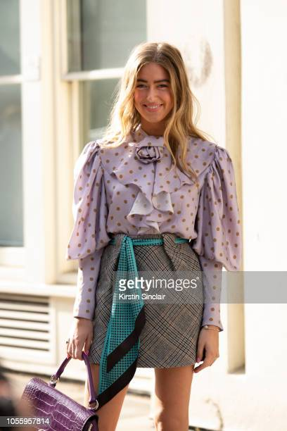 Fashion Stylist Emili Sindlev wears a JW Anderson bag Mulberry shirt scarf and skirt during London Fashion Week September 2018 on September 15 2018...