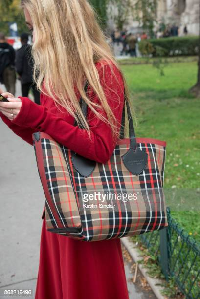 Fashion stylist Emili Sindlev wears a J.W Anderson sweater and skirt, Burberry bag day 3 of Paris Womens Fashion Week Spring/Summer 2018, on...