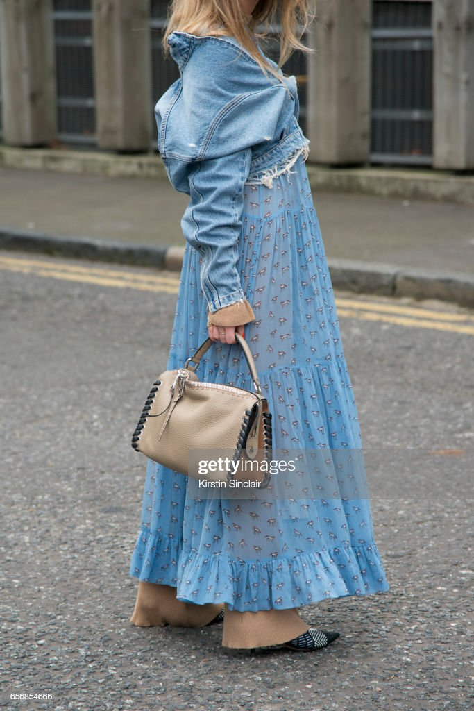Fashion stylist Emili Sindlev wears Celine shoes, Fendi bag, Baum und Pferdgarten dress, Stine Goya trousers, Won Hundred jacket on day 3 of London Womens Fashion Week Autumn/Winter 2017, on February 19, 2017 in London, England.