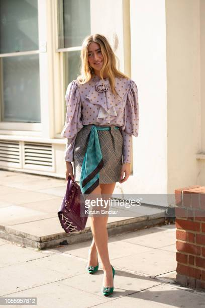 Fashion Stylist Emili Sindlev wears Manolo Blahnik shoes JW Anderson bag Mulberry shirt scarf and skirt during London Fashion Week September 2018 on...