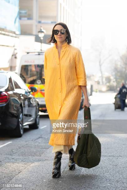 Fashion stylist Emily Evans wears a Rocket vintage jacket Uooyaa bag and Vetements boots during London Fashion Week February 2019 on February 15 2019...