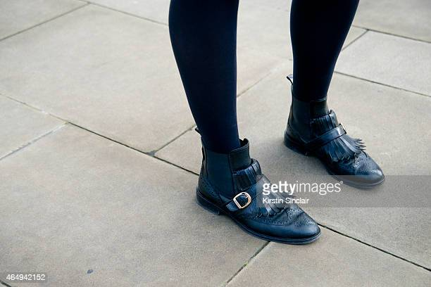 Fashion stylist Emily Outhwaite wears Russell and Bromley boots on February 24 2015 in London England