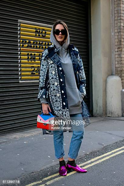 e873fb43914a Fashion stylist Estelle Pigault wears a Sacai jacket Gucci shoes Fendi bag Forever  21 hooded top