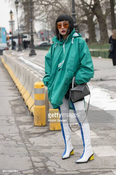 Fashion stylist founder and director of Alter China Sonja Long Xiao wears Marques Almeida boots Complet bag Moy Atelier sunglasses and a Martine Rose...