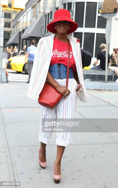 Fashion stylist Janelle Henderson wearing a vintage suit poses in the Spring/Summer 2018 womenswear collection shows during New York Fashion Week at...