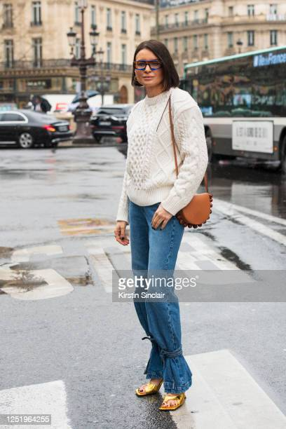 Fashion stylist Joanna Helena Horodynska wears a Loewe bag Bottega Veneta shoes Reserved jumper Loewe jeans and Jacquemus sunglasses on March 02 2020...