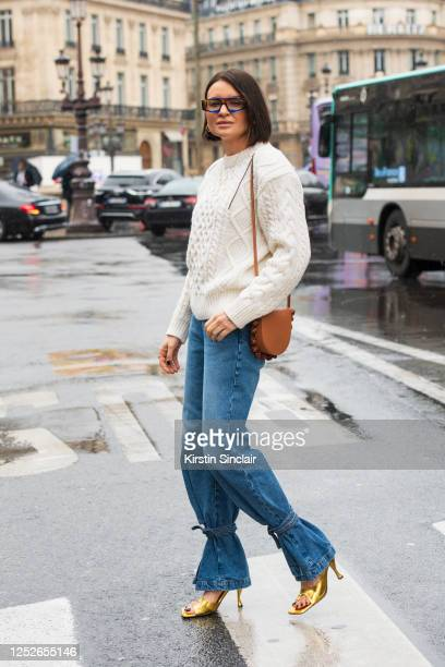 Fashion stylist Joanna Helena Horodynska wears a Loewe bag, Bottega Veneta shoes, Reserved jumper, The Frankie Shop coat, Loewe jeans and Jacquemus...