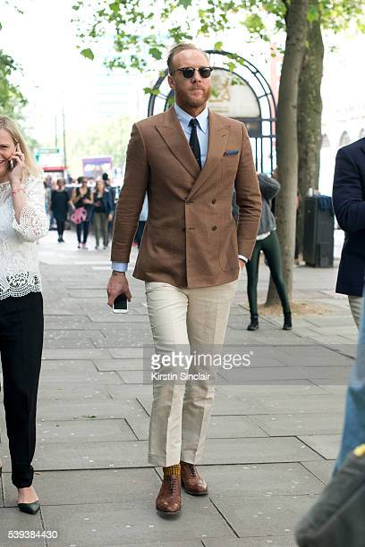 Fashion Stylist Joe Ottaway wearing a Gieves and Hawkes jacket on day 1 of London Collections Men on June 10 2016 in London England
