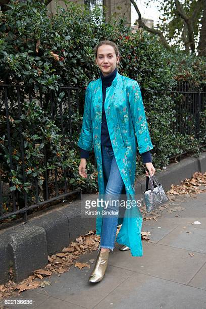 Fashion Stylist Laurel Pantin wears a vintage silk Kimono jacket and a Chanel bag day 4 of London Womens Fashion Week Spring/Summer 2016, on...