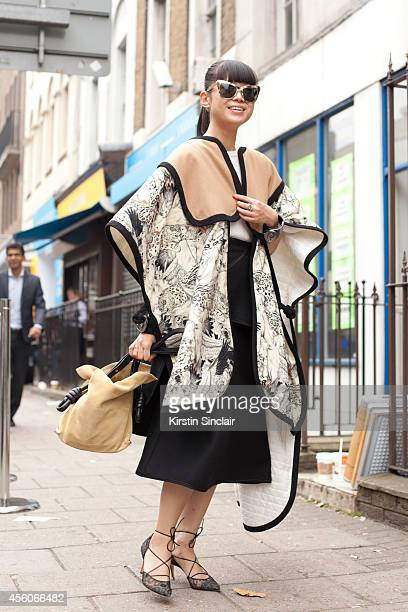 Fashion Stylist Leaf Greener is wearing a Swash London cape Reve by Rene sunglasses Chanel cuffs Les Valentine knit Celine skirt and Bionda Castana...