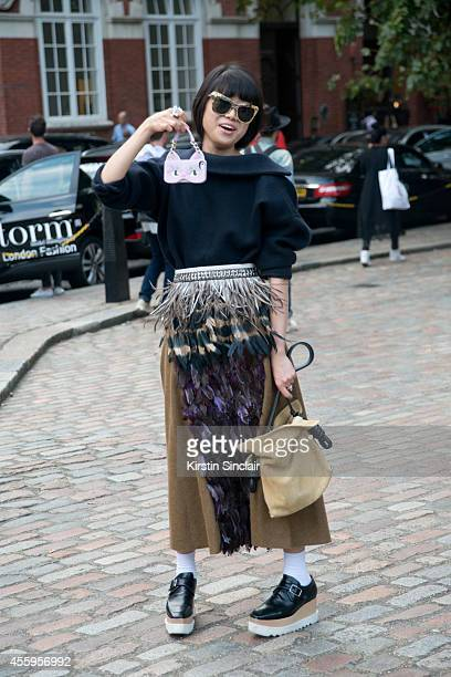 Fashion Stylist Leaf Greener Marni top and skirt Pamela Constantini boots Loewe bag and Rene by Rene sunglasses on day 4 of London Collections Women...