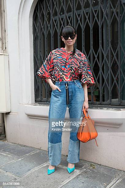 Fashion Stylist Leaf Greener wears a Balenciaga shirt Of White jeans Loewe bag and Gianvito Rossi shoes on day 1 of Paris Collections Men on June 22...