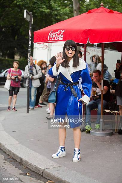 Fashion Stylist Leaf Greener wears a Celine coat Moynat purse and Prada sneakers before Dior on Day 2 of Paris Haute Couture Fashion Week...