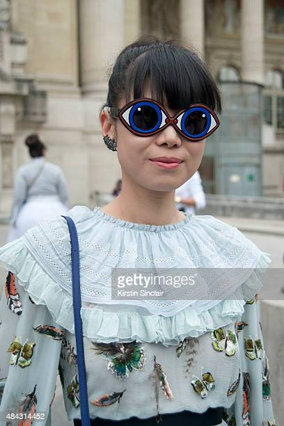 Fashion Stylist Leaf Greener wears a Chanel dress Celine bag Yasbuki sunglasses on day 3 of Paris Fashion Week Haute Couture Autumn/Winter 2015 on...