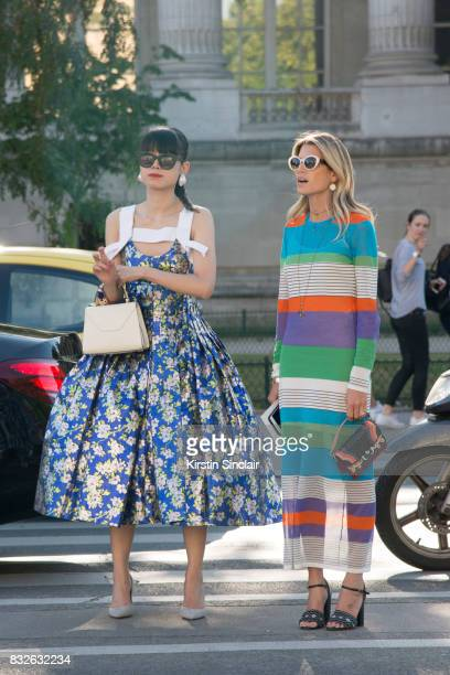 Fashion stylist Leaf Greener wears a Delpozo dress Valextra bag and Thierry Lasry sunglasses with Fashion blogger Helena Bordon wearing a Diana Von...