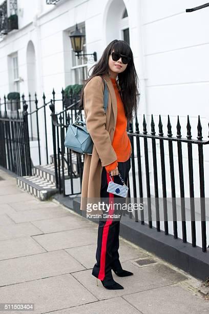 Fashion stylist Leaf Greener wears a Joseph coat and trousers AM Eyewear sunglasses Kurt Geiger shoes and Loewe bag on day 2 during London Fashion...