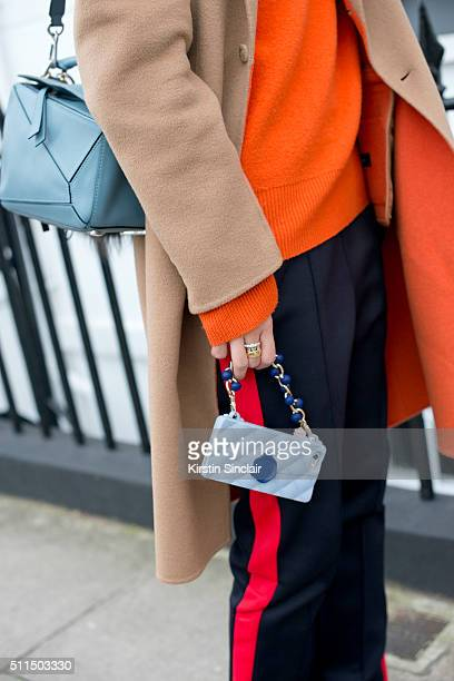 Fashion stylist Leaf Greener wears a Joseph coat and trousers and Loewe bag on day 2 during London Fashion Week Autumn/Winter 2016/17 on February 20...