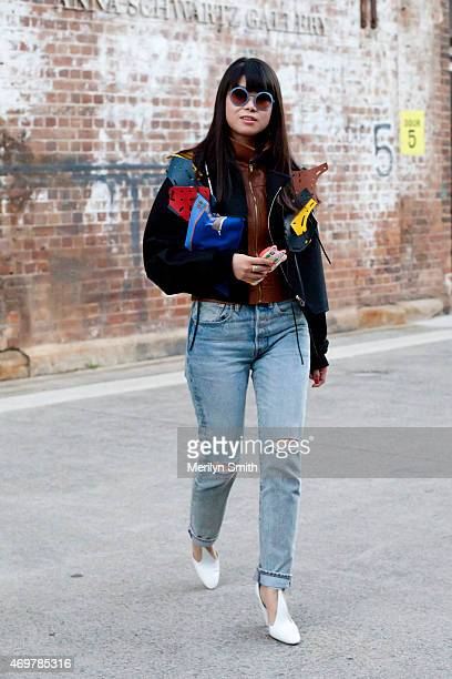 Fashion Stylist Leaf Greener wears a Loewe menswear jacket and clutch Kate Sylvester top Am Eyewear sunglasses and Celine shoes at MercedesBenz...