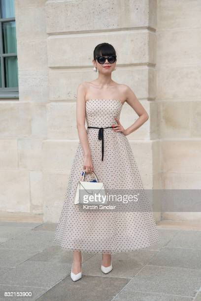 Fashion stylist Leaf Greener wears a Monique L'Huillier dress Valextra bag Thierry Lasry sunglasses and Gianvito Rossi shoes day 2 of Paris Haute...