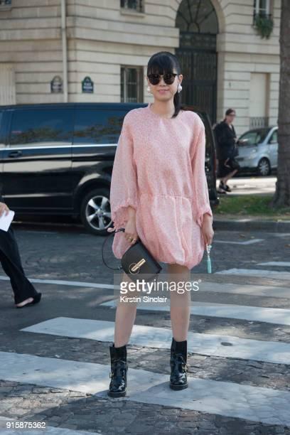 Fashion stylist Leaf Greener wears a Nina Ricci bag Gentle monster sunglasses Louis Vuitton boots and a Maison Rabih Kayrouz dress day 4 of Paris...