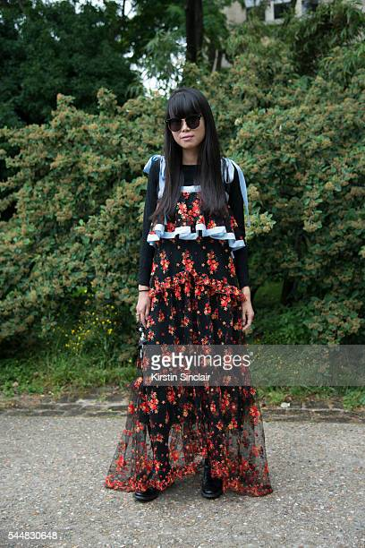 Fashion Stylist Leaf Greener wears a Philosophy di Alberta Ferretti dress Perrin bag and Gentle Monster sunglasses on day 1 of Paris Haute Couture...