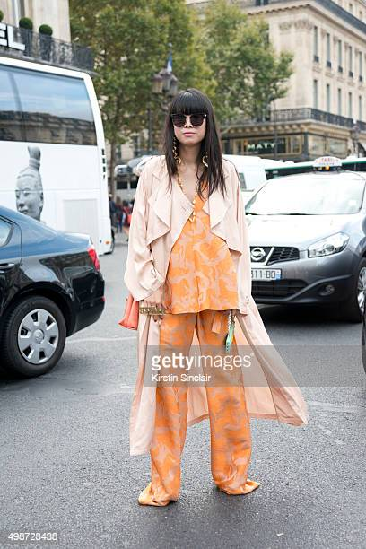 Fashion Stylist Leaf Greener wears Alessandra Rich sunglasses Stella McCartney top trousers jacket and bag and a Candies gifts iphone case on day 7...