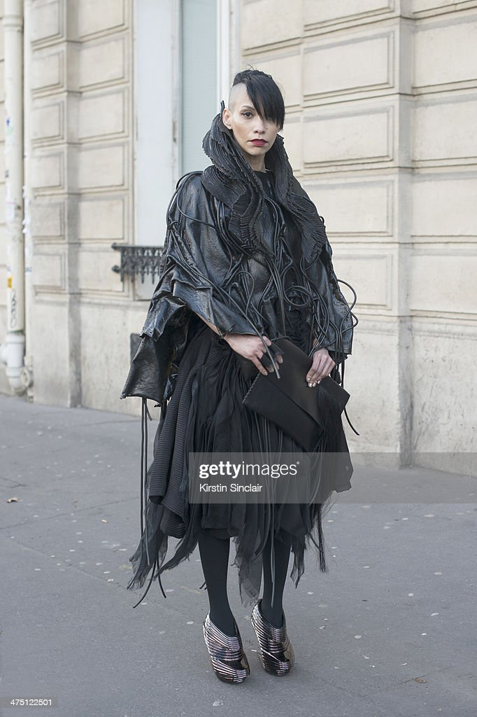 Fashion Stylist Lily Gatkins wears a Jorge Ayala dress and bag and Nude Rebulic shoes on day 2 of Paris Collections: Women on February 26, 2014 in Paris, France.