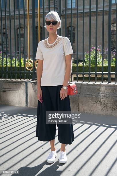 Fashion Stylist Linda Tol is wearing a Furla bag, Tibi culottes, and Etre Cecile on day 4 of Paris Collections: Women on September 26, 2014 in Paris,...
