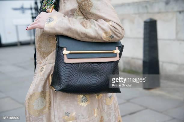 Fashion stylist Mary Fellowes wears a Prada coat Chloe bag on day 4 of London Womens Fashion Week Autumn/Winter 2017 on February 20 2017 in London...
