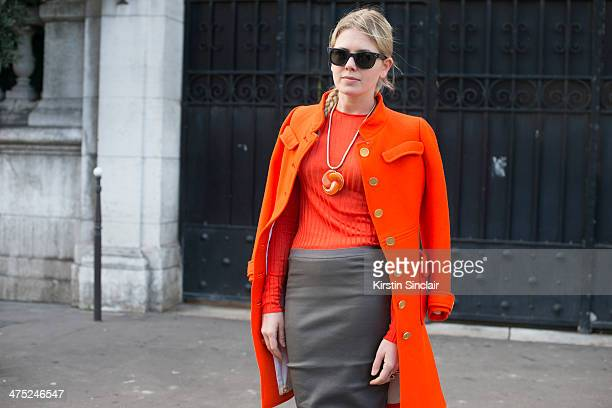 Fashion Stylist Megan Gray wears a Courreges coat Rick Owens skirt Wolford stockings Oliver Peoples sunglasses and Celine sweater on day 2 of Paris...