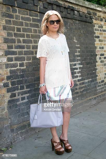 Fashion stylist Natalie Mark wears Ira T shirt, Prada bag, Preen skirt, Miu Miu sunglasses and Fendi shoes on day 4 of London Collections: Men on...