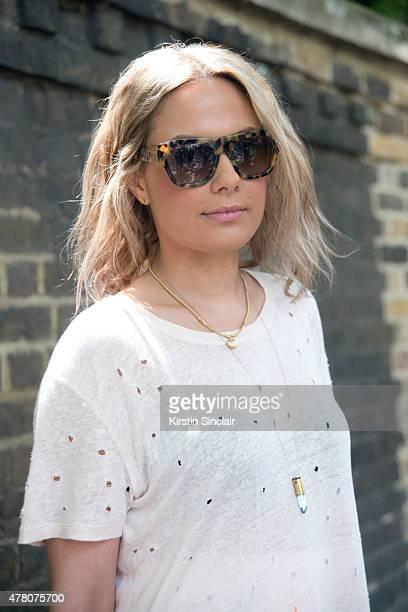 Fashion stylist Natalie Mark wears Ira T shirt, Prada bag, Preen skirt, Miu Miu sunglasses on day 4 of London Collections: Men on June 15, 2015 in...