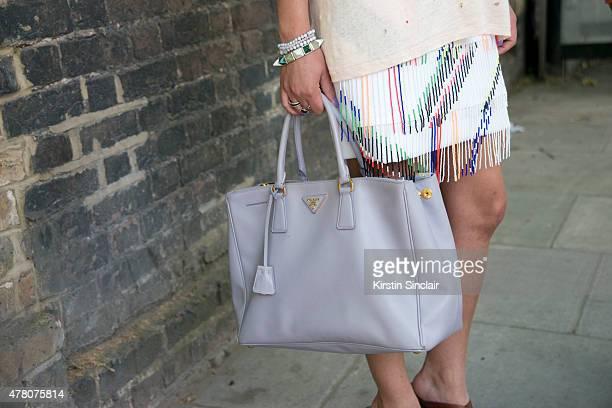 Fashion stylist Natalie Mark wears Ira T shirt, Prada bag, Preen skirt on day 4 of London Collections: Men on June 15, 2015 in London, England.