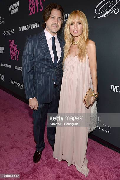 Fashion stylist Rachel Zoe and Rodger Berman attend Elyse Walker Presents The Pink Party 2013 hosted by Anne Hathaway at Barker Hangar on October 19...