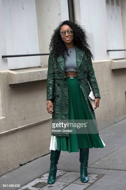 Fashion stylist Shiona Turini wears a Fendi coat Valentino top and skirt Dior sunglasses Aquazurra boots and M2Malletier bag day 4 of Paris Womens...