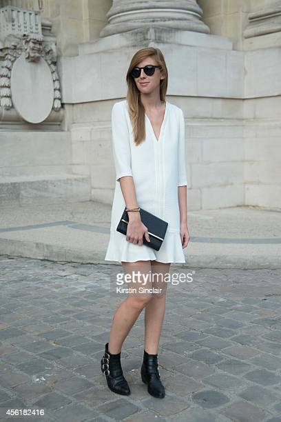 Fashion Stylist Sonia Logerot is wearing Toga boots Bash dress Zara bag and Illesteva sunglasses on day 2 of Paris Collections Women on September 24...