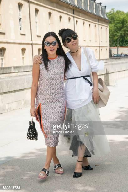 Fashion stylist Tina Leung wears a Marni dress Miu Miu shoes Delphine Delafon bag and Prism sunglasses with Fashion writer Susanna Lau wearing all...