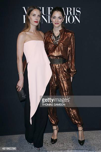 US fashion stylist Vanessa Traina and Argentinian art director Sofia Sanchez Barrenechea pose at the 'Vogue Paris Foundation' party in Paris on July...