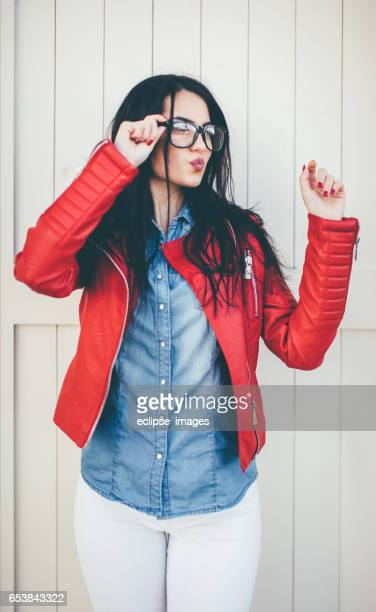 fashion sweet woman having fun - red jacket stock pictures, royalty-free photos & images