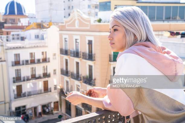fashion tourist looking mediterranean city in balcony - white hair stock pictures, royalty-free photos & images