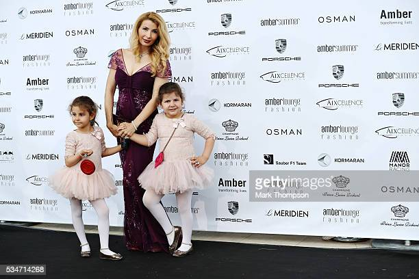 Fashion TV presenter Ivana Ilic-Labia arrives at the Amber Lounge fashion show with her daughters Lana and Yana Labia during previews to the Monaco...