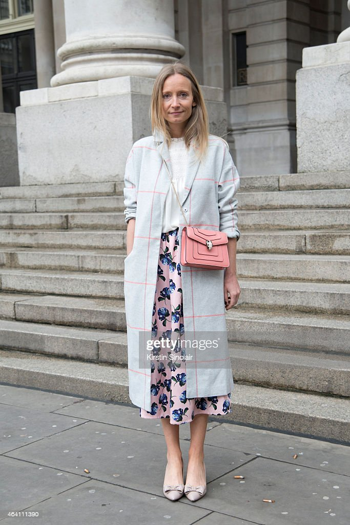 Fashion TV Presenter Martha Ward wears an Asos coat, Valentino shoes, Mother of Pearl skirt, Bvlgari bag, Mayla blouse on February 21, 2015 in London, England.