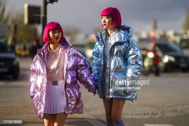 "Fashion twins Ami and Aya ""AmiAya"" are seen ; a guest wears a pink polo shirt, a purple shiny puffer coat, pink long socks, platform shoes ; a guest..."