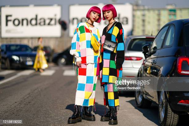 "Fashion twins Ami Zuzuki and Aya Suzuki ""AmiAya"" wear earrings, a necklace, a colorful patchwork tunic, a colorful patchwork long skirt, a crossbody..."