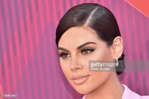 Fashion Vlogger Nazanin Kavari arrives for the 2019 iHeart Radio Music Awards at the Microsoft theatre on March 14 2019 in Los Angeles California
