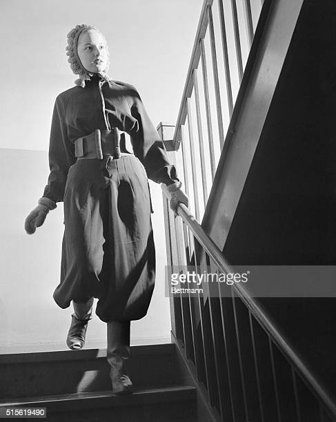 Fashion was undergoing a rapid metamorphosis to meet the wartime requirements of American women for clothing with trim free action lines as shown...