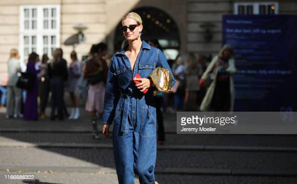 Fashion Week guest a jeans overall on August 07, 2019 in Copenhagen, Denmark.