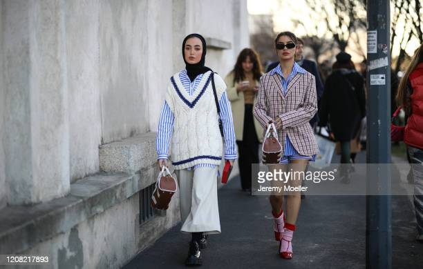 Fashion Week guest is seen before Prada during Milan Fashion Week Fall/Winter 2020-2021 on February 20, 2020 in Milan, Italy.