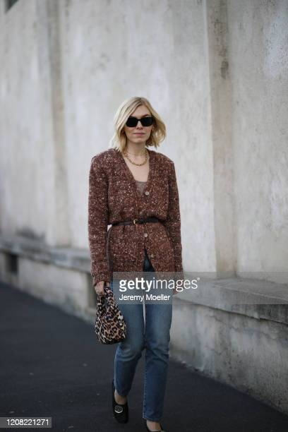 Fashion Week guest is seen before Prada during Milan Fashion Week Fall/Winter 20202021 on February 20 2020 in Milan Italy